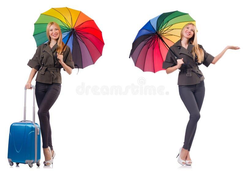 Mulher com a mala de viagem e o guarda-chuva isolados no branco fotos de stock