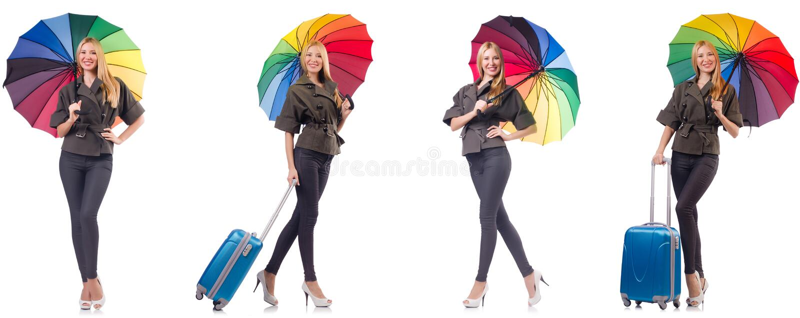 Mulher com a mala de viagem e o guarda-chuva isolados no branco imagem de stock royalty free