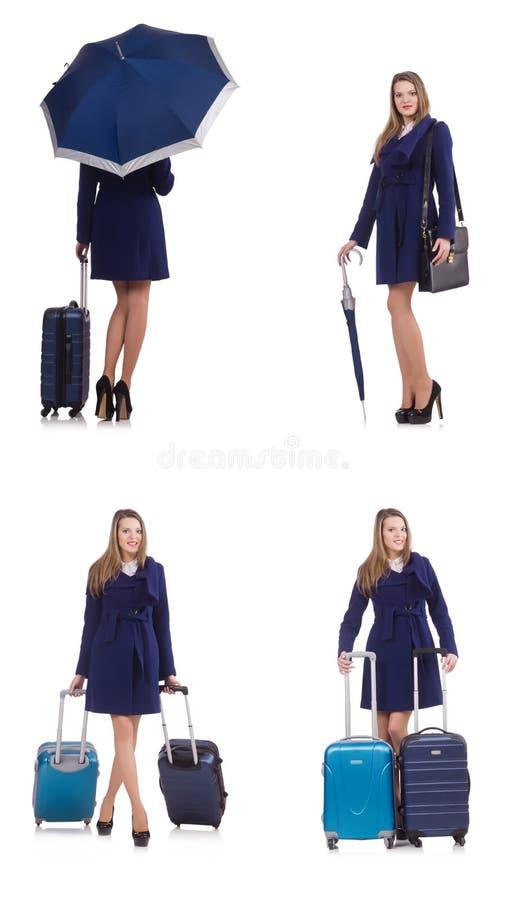 A mulher com a mala de viagem e o guarda-chuva isolados no branco imagem de stock royalty free