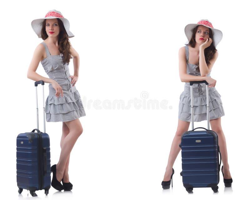 A mulher com a mala de viagem isolada no branco fotos de stock royalty free