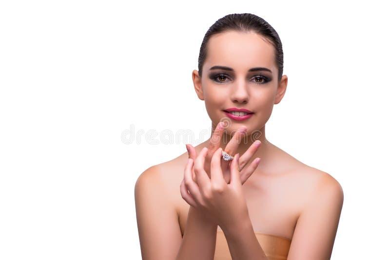 A mulher com o anel de noivado isolado no branco imagens de stock