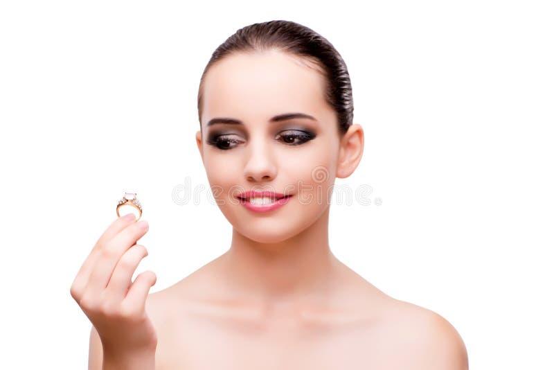 A mulher com o anel de noivado isolado no branco fotos de stock