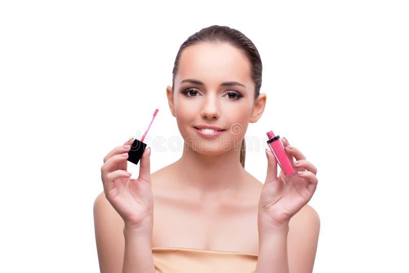 A mulher com o batom cor-de-rosa isolado no branco imagem de stock