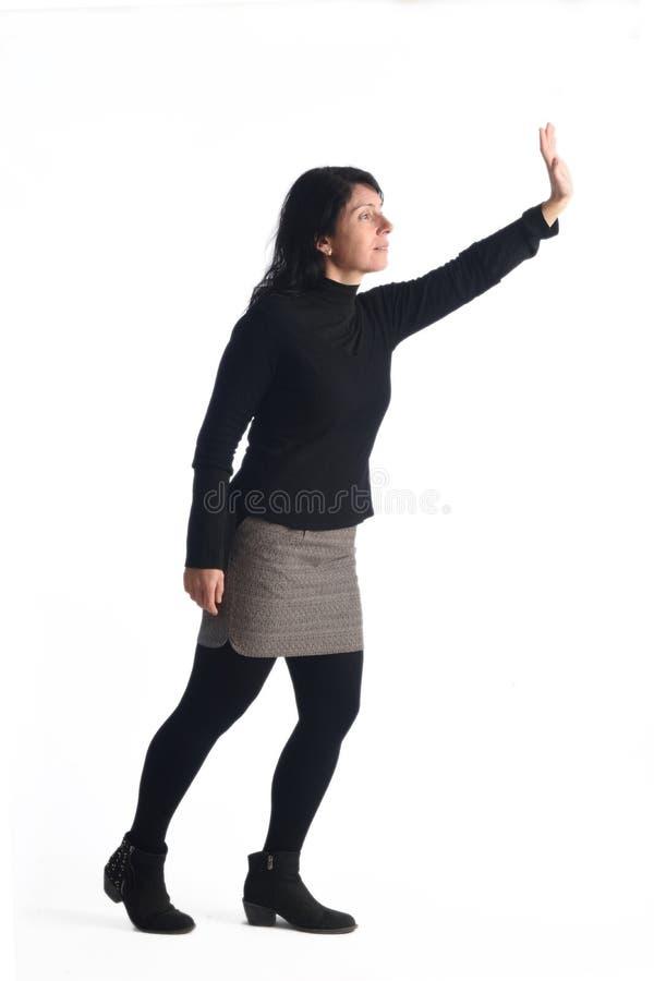 Mulher com o braço aumentado imagem de stock royalty free
