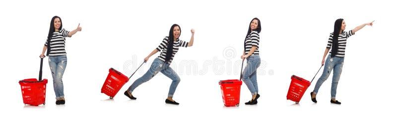 A mulher com o carrinho de compras isolado no branco imagens de stock royalty free