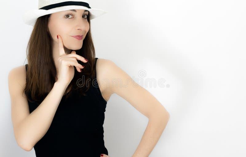 Mulher com o dedo no mordente imagens de stock royalty free