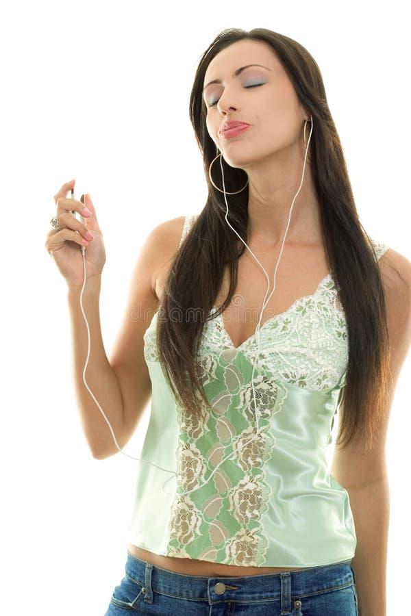 Mulher com o jogador MP3 foto de stock