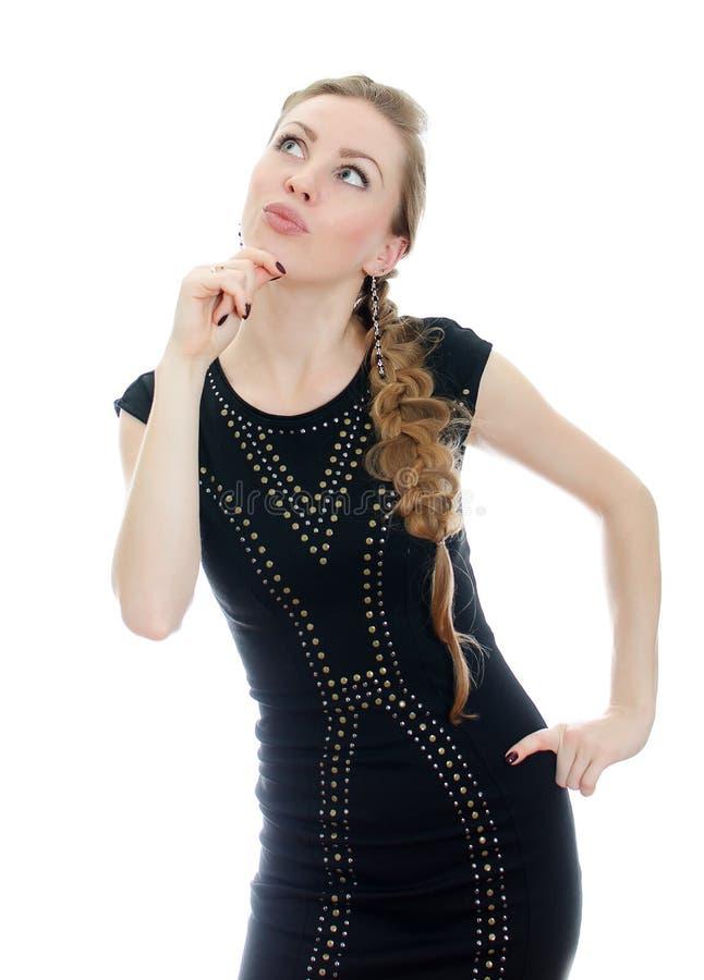 Mulher com o pigtail no vestido preto foto de stock