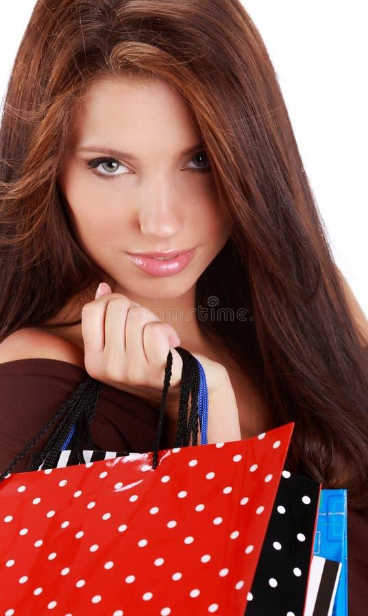Mulher com o saco de compra colorido imagem de stock