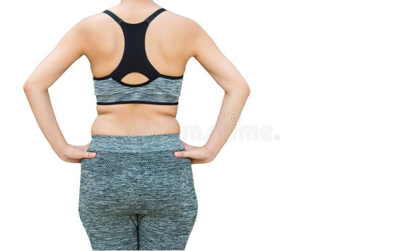 mulher com o sportswear vestindo gordo da barriga que prepara-se para a ioga, iso fotografia de stock