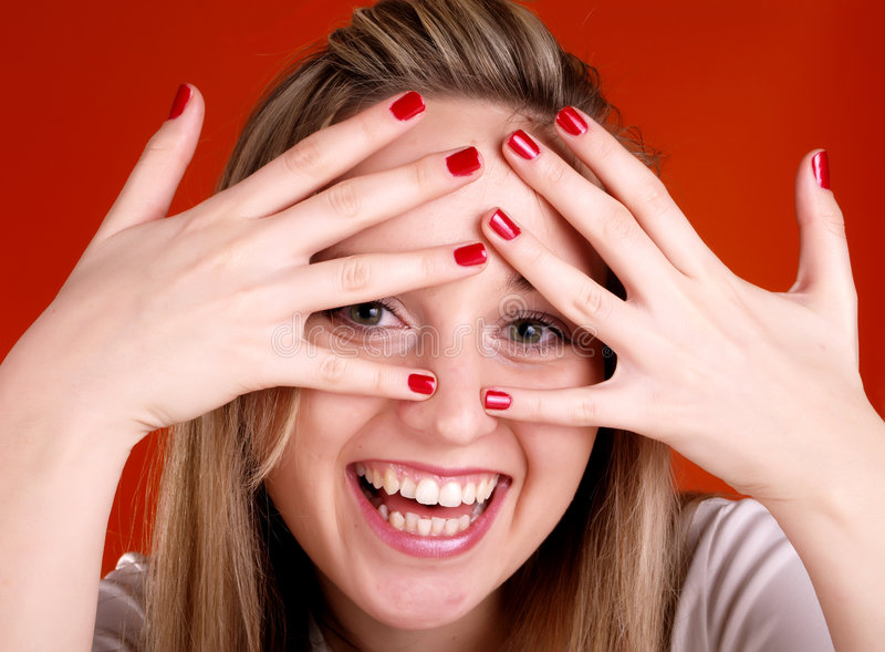 Mulher com os dedos sobre sua face fotos de stock royalty free