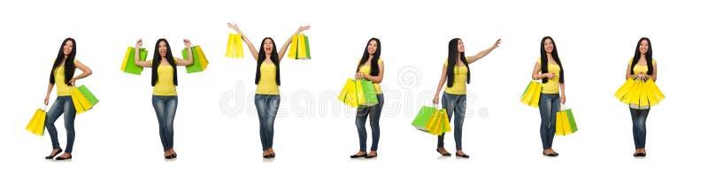 A mulher com os sacos de compras isolados no branco imagens de stock