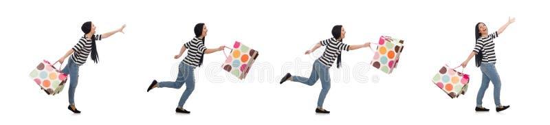 A mulher com os sacos de compras isolados no branco foto de stock royalty free