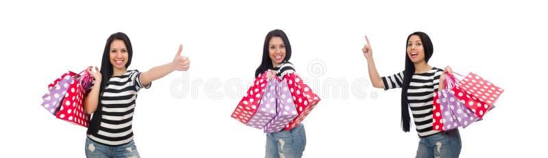 A mulher com os sacos de compras isolados no branco foto de stock