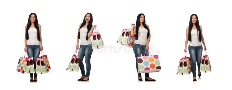 A mulher com os sacos de compras isolados no branco fotografia de stock royalty free