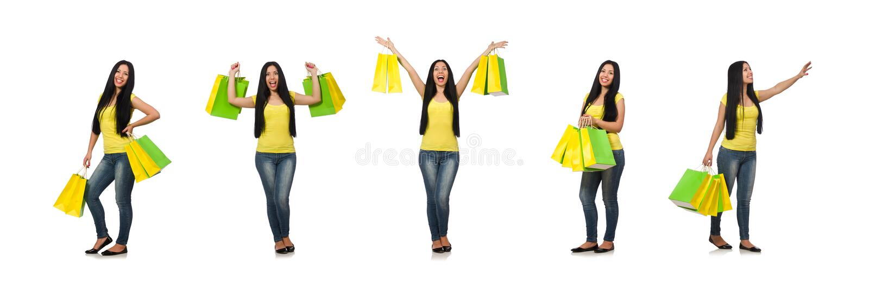 Mulher com os sacos de compras isolados no branco fotografia de stock