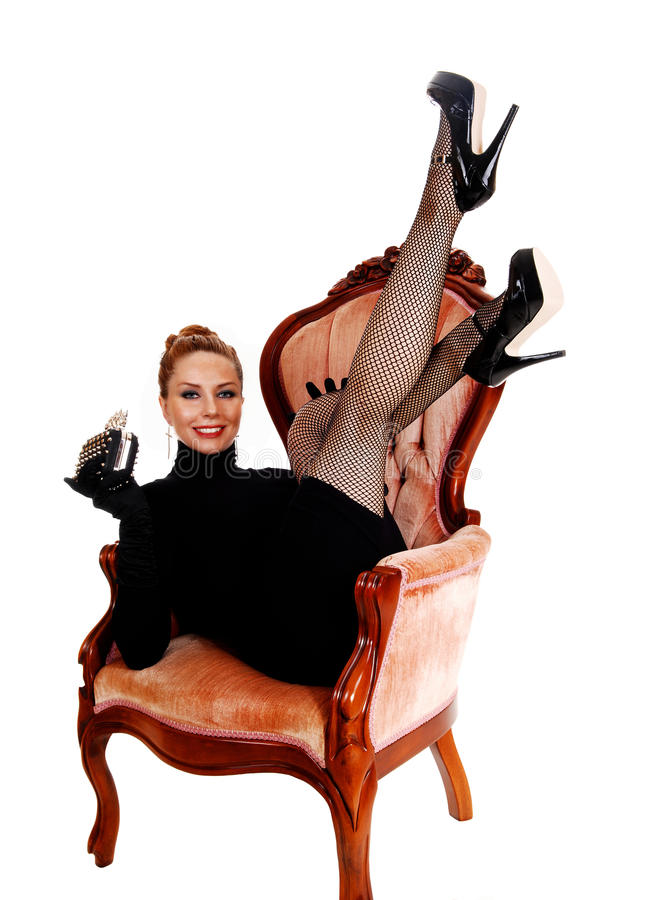 Mulher com pés acima imagem de stock