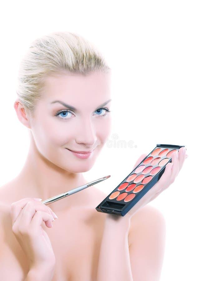 Mulher com paleta do batom imagens de stock