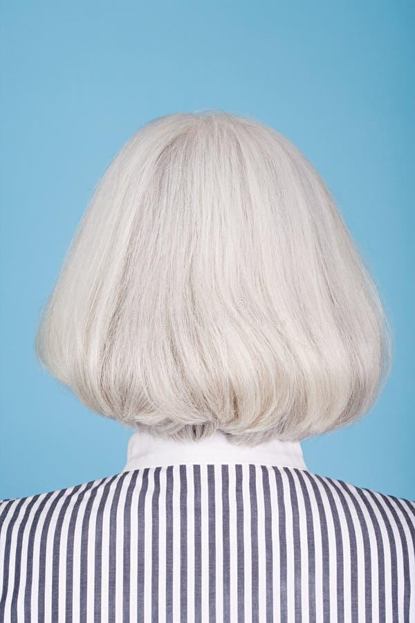 Mulher com penteado do prumo foto de stock