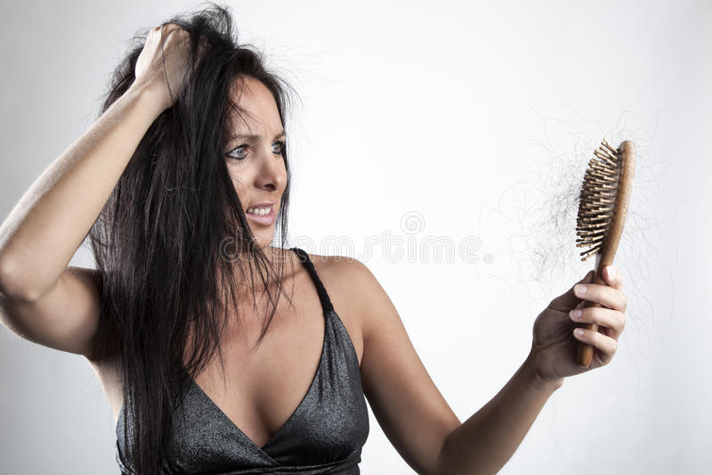 Mulher com perda de cabelo fotos de stock