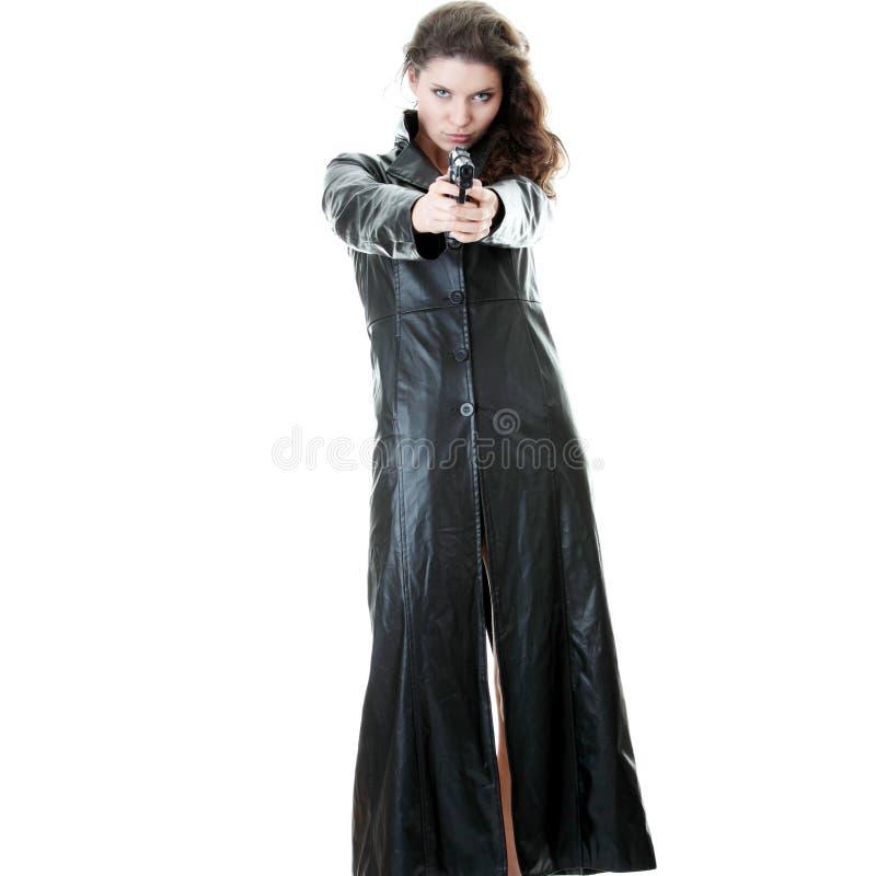 Mulher com revólver fotografia de stock