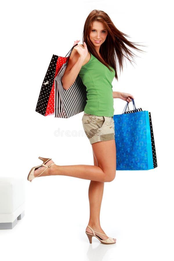 Mulher com sacos de compra. fotografia de stock