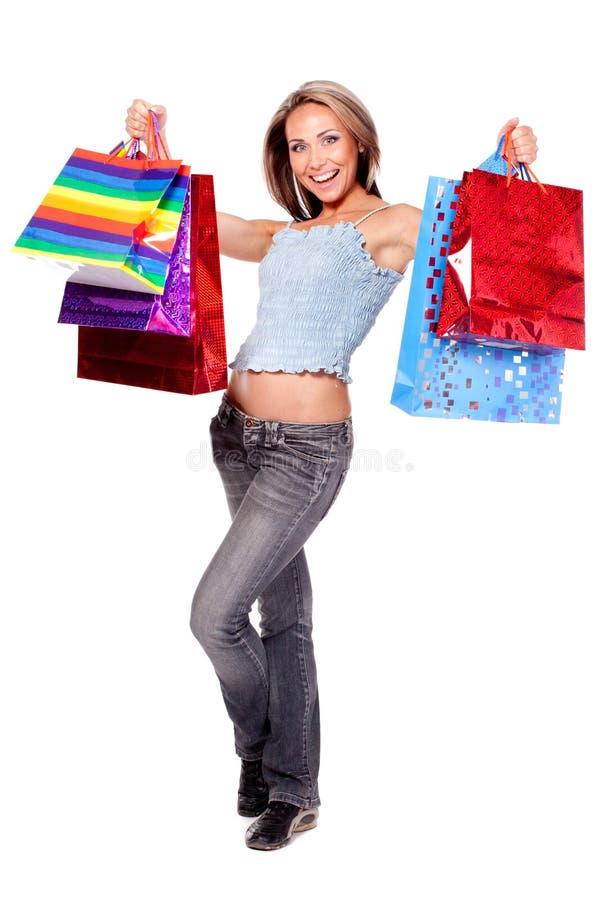 Mulher com sacos de compra imagem de stock