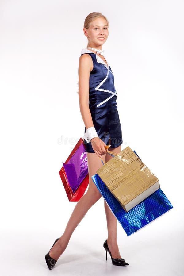 Mulher com sacos de compra fotos de stock royalty free