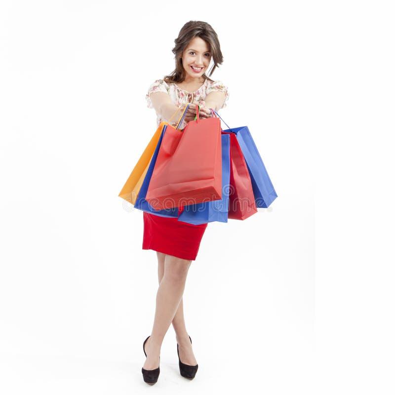 Mulher com sacos de compra foto de stock