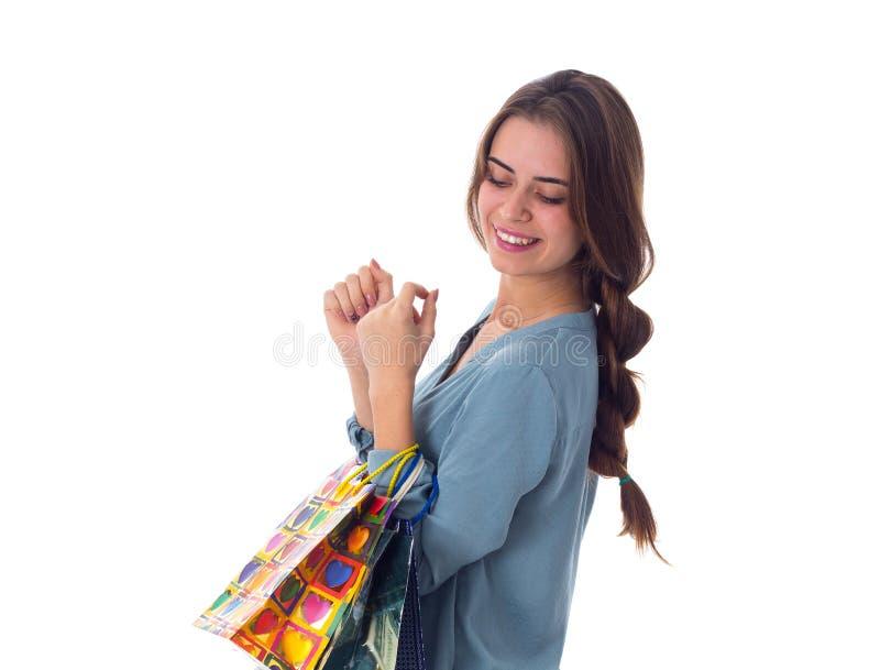 Mulher com sacos de compra fotografia de stock