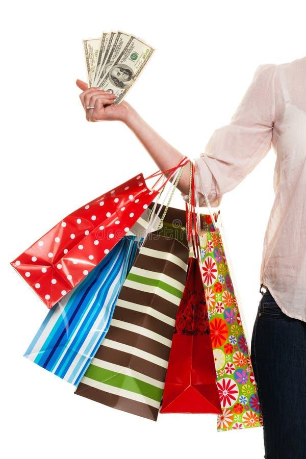 Mulher com sacos de compras ao comprar fotografia de stock royalty free