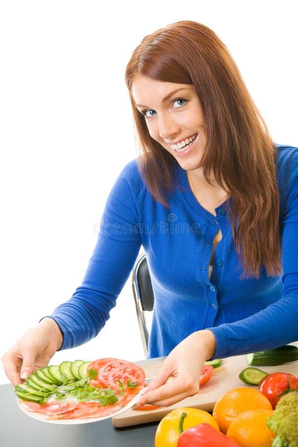 Mulher com salada do vegetariano foto de stock