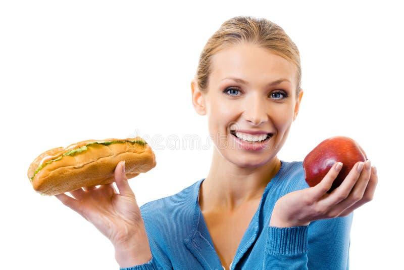 Mulher com sanduíche e maçã imagem de stock royalty free