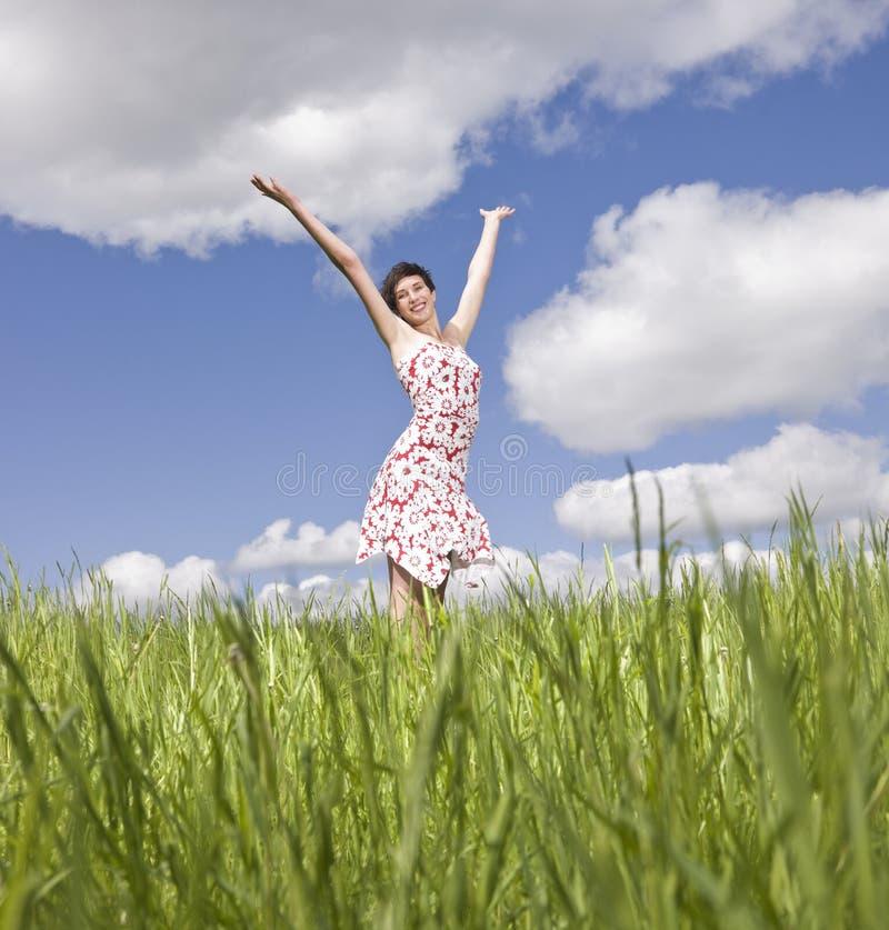 Mulher com seus braços levantados fotos de stock royalty free