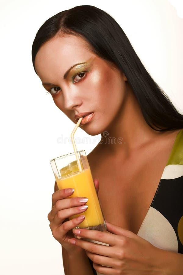 Mulher com sumo de laranja foto de stock