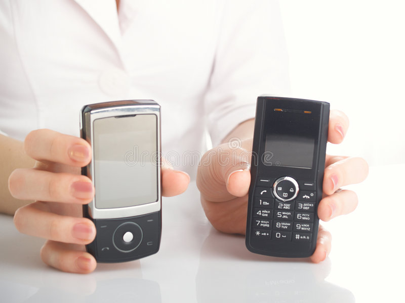 Mulher com telefones móveis fotos de stock