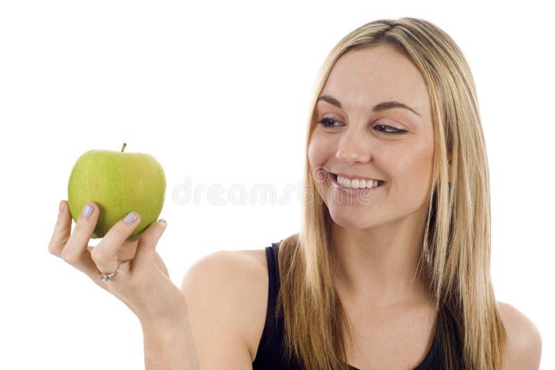 Mulher com um Apple imagem de stock