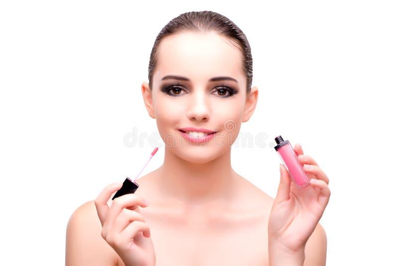 A mulher com um batom isolado no branco imagens de stock