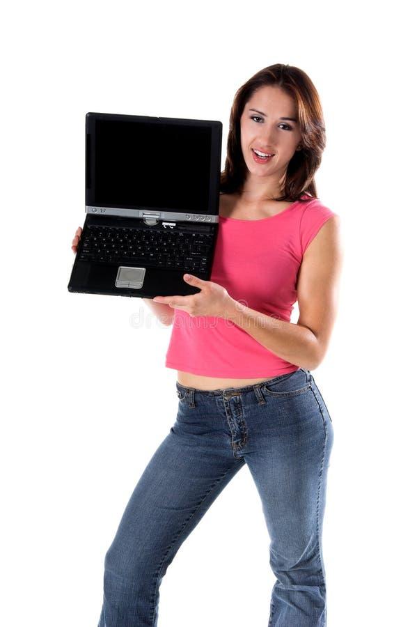 Mulher com um computador portátil imagens de stock