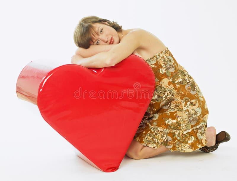 Mulher com um coração fotos de stock