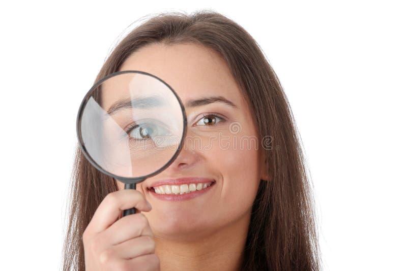 A mulher com um magnifier foto de stock royalty free