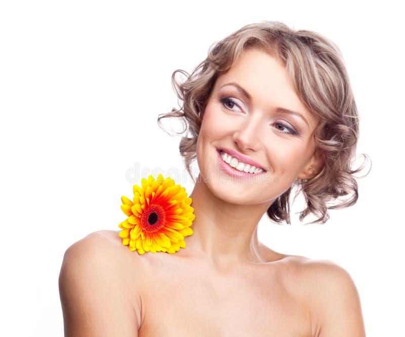 Mulher com uma flor imagens de stock