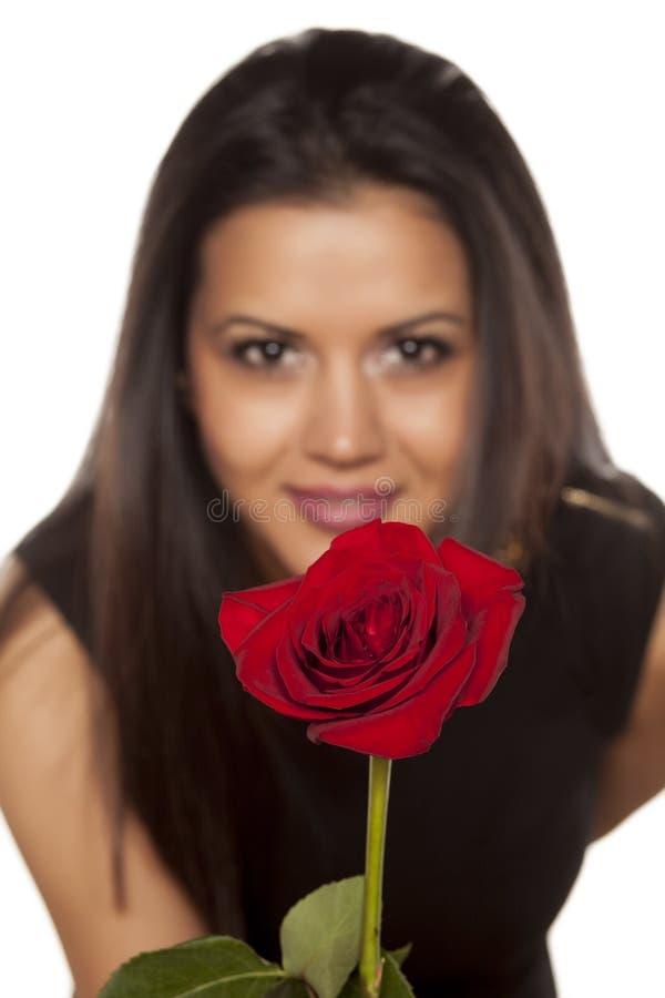 Mulher com uma rosa foto de stock