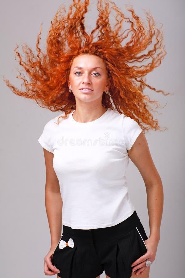 Mulher com vôo do cabelo fotos de stock