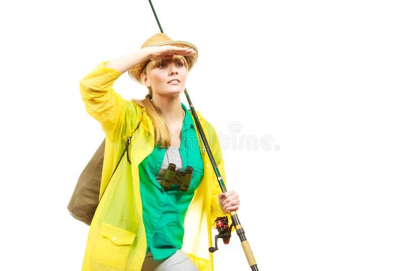 Mulher com vara de pesca, equipamento de giro imagens de stock