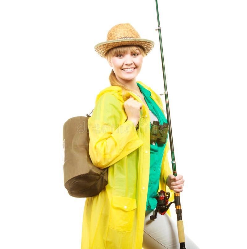 Mulher com vara de pesca, equipamento de giro foto de stock royalty free