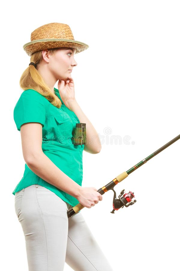 Mulher com vara de pesca, equipamento de giro foto de stock