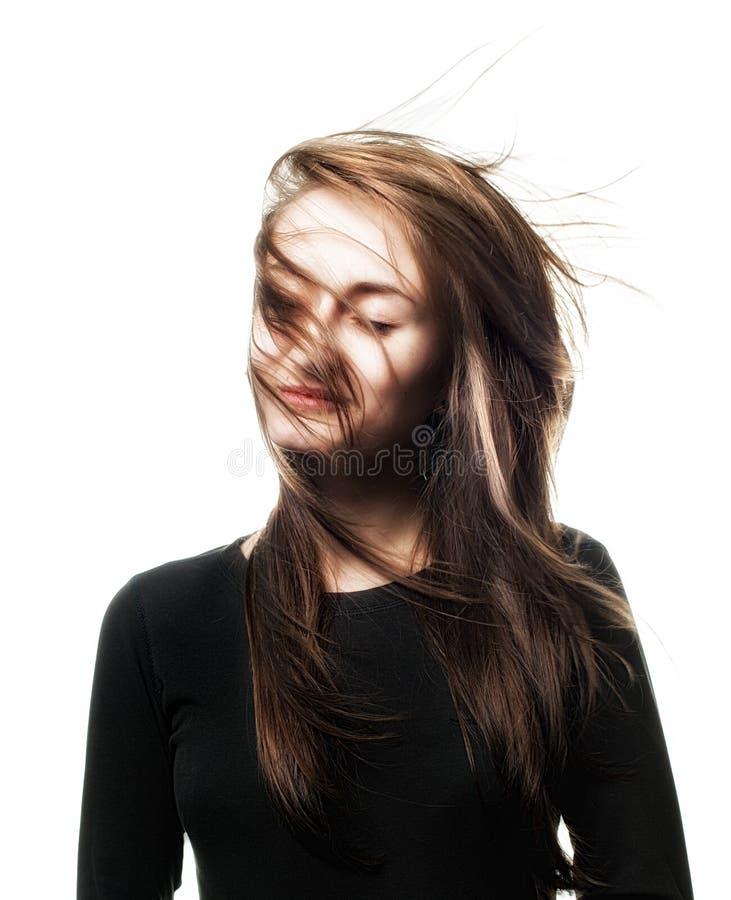 Mulher com vento no cabelo imagem de stock