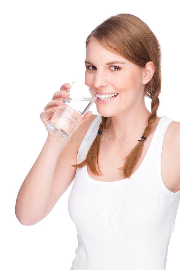 Mulher com vidro da água fotos de stock royalty free