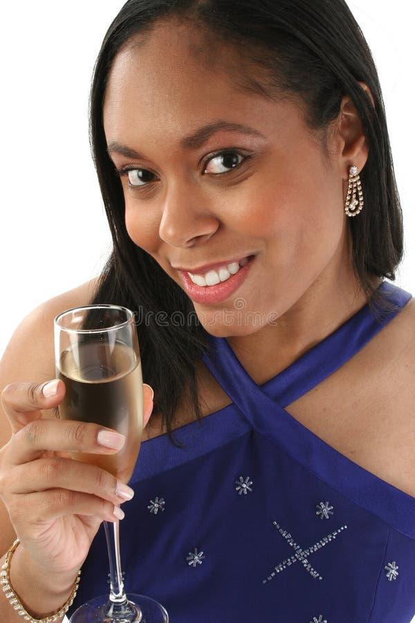 Mulher com vidro de Champagne fotografia de stock